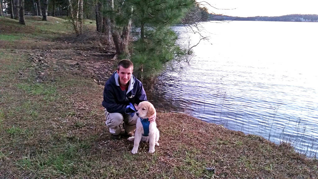 Golden Retriever Meeko at the lake with daddy.